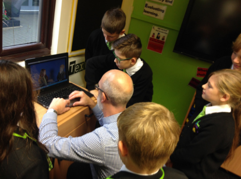 Tim helping SEJ pupils edit